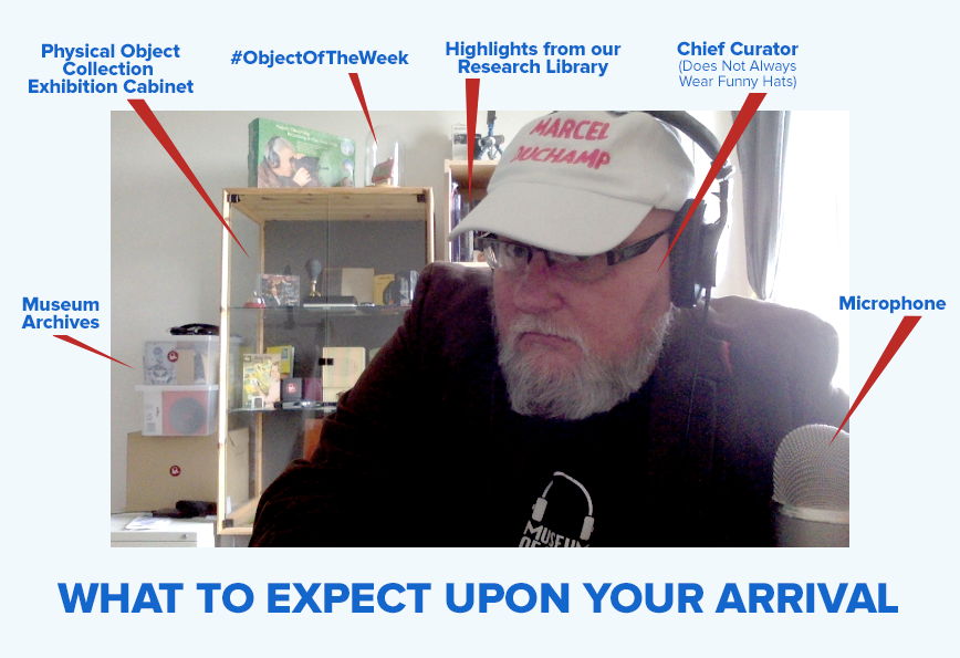 An annotated image of what an Online Visitor sees upon entering the video chat room, including our Museum Archives, our Physical Object Collection Exhibition Cabinet, Our #ObjectOfTheWeek vitrine, a bookshelf containing highlights from our Research Library, our Chief Curator, and a Microphone.